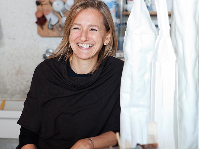 Smiling woman in art studio