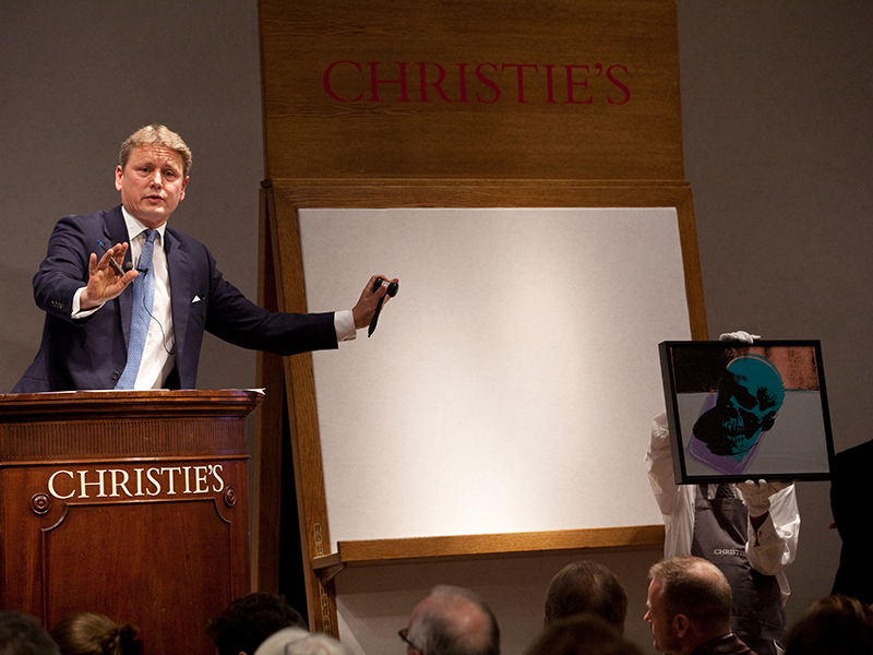 Auctioneer taking bids at Christie's Auction house, Old Bond Street, London, UK. Photo:Jeff Gilbert