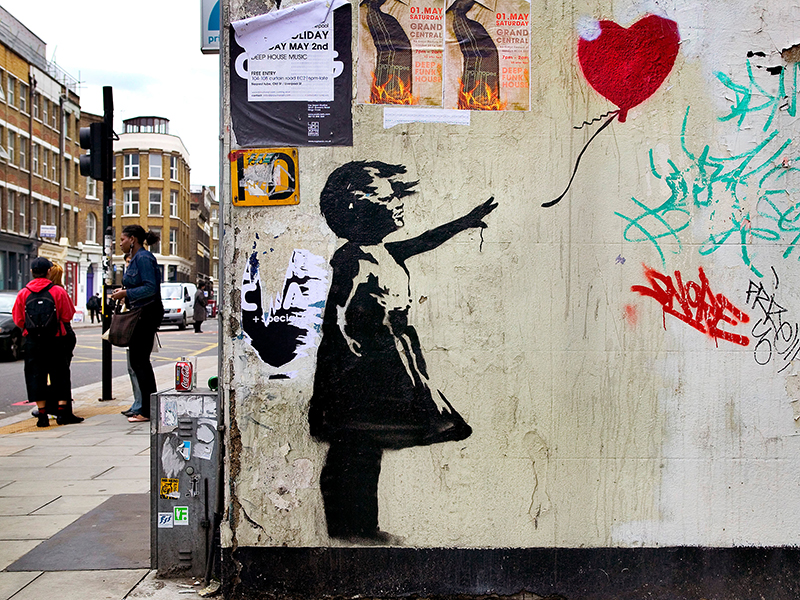 Banksy stencil of girl with balloon in red, London