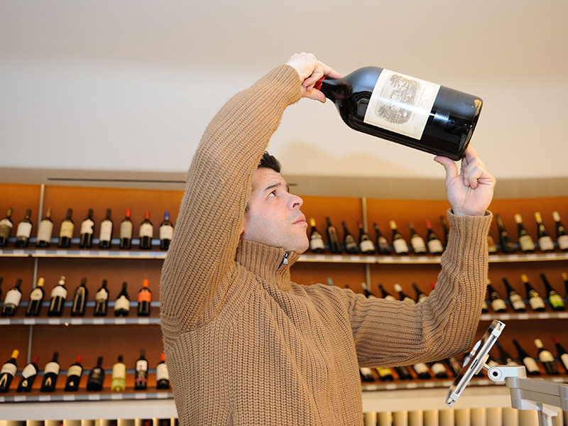 man-holding-large-bottle-of-red-wine-Alamy