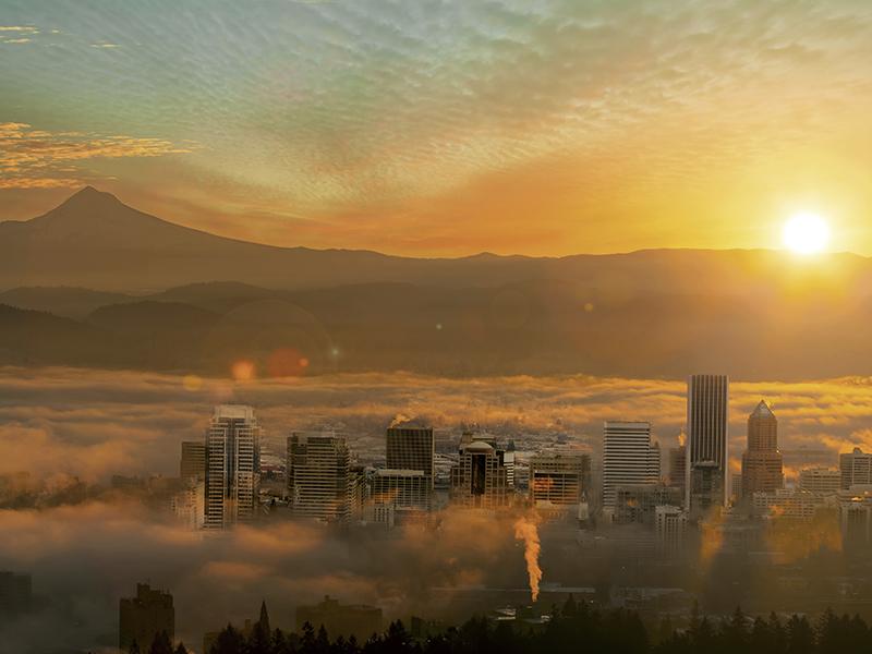 Portland skyline in fog by Mount Hood