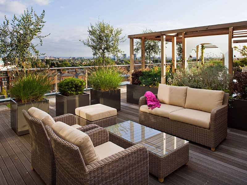 London roof garden with wicker furniture