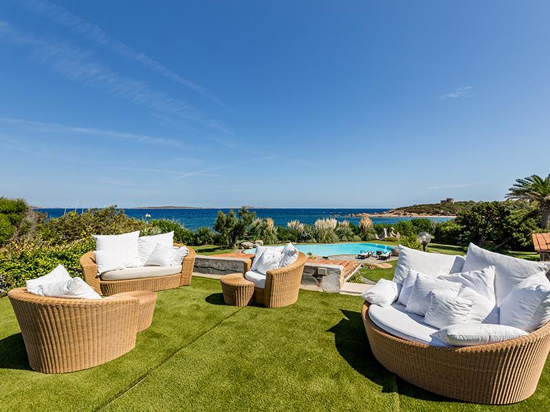 Garden seating overlooking pool and sea