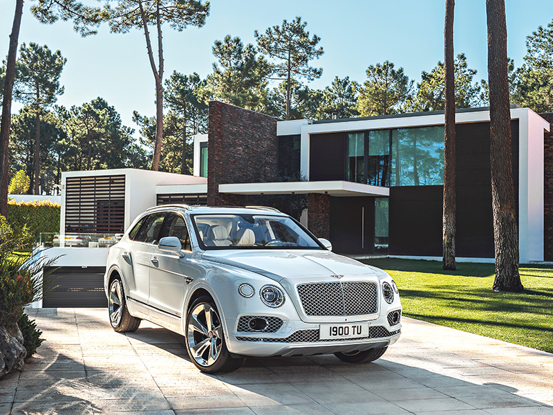 Bentley car in modern home's driveway