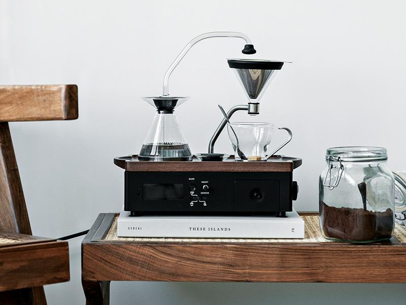 Coffe-making machine on bedside cabinet