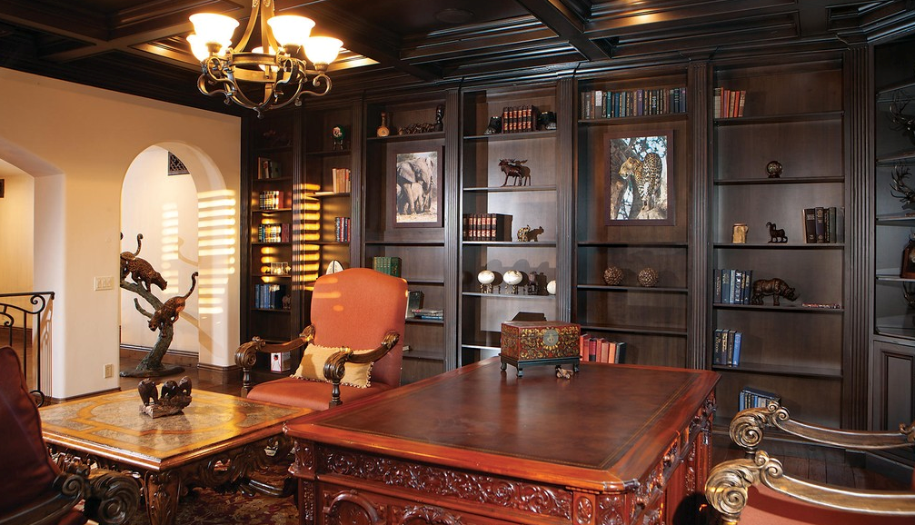 Renaissance-inspired details abound at this villa in Scottsdale, Arizona. Among the highlights is an executive office with a coffered wood ceiling with wrought-iron chandelier, built-in bookcases, antique furniture and objets d'art.