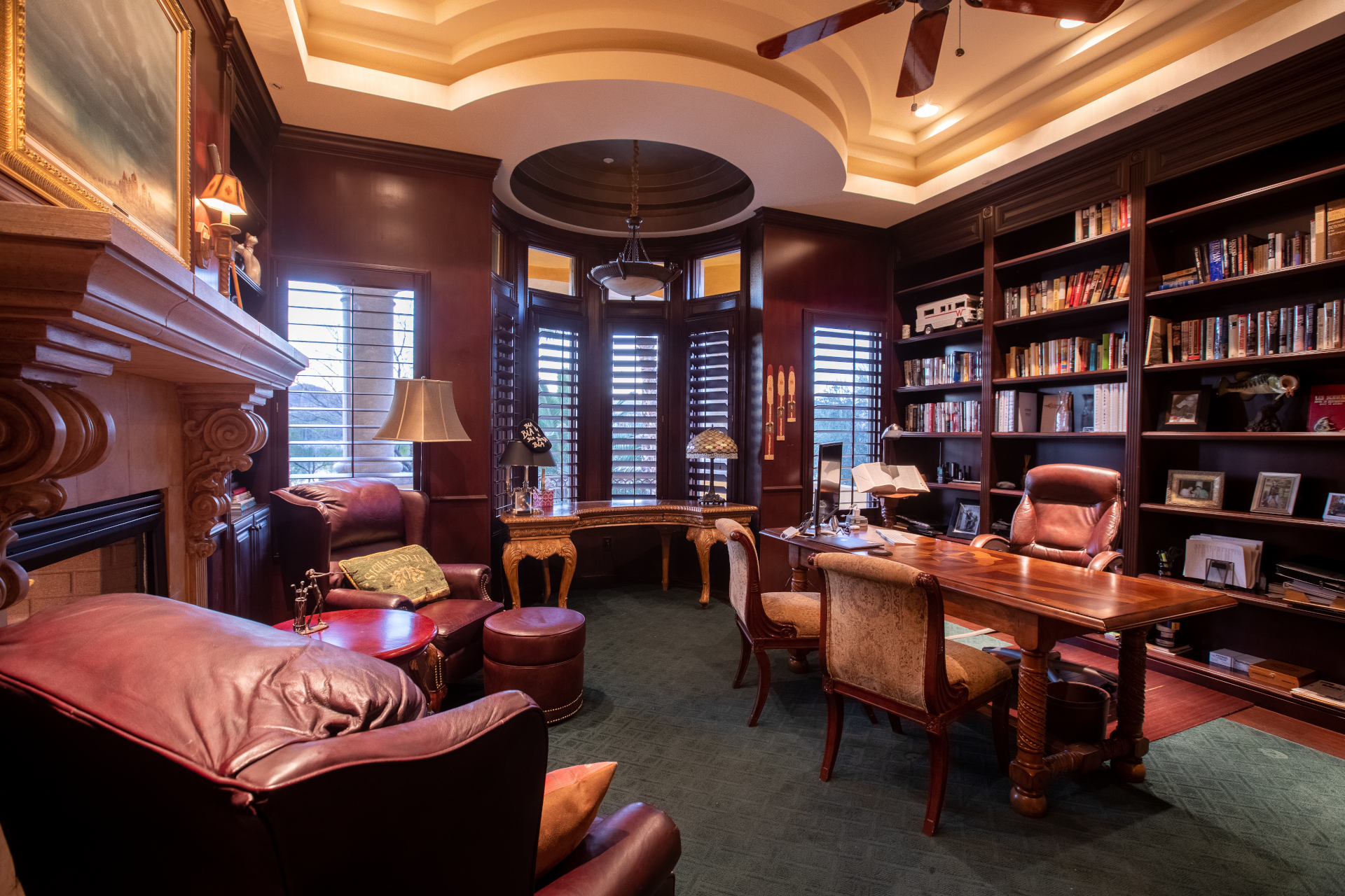 A beautiful wood-panelled library with office space is among the lavish appointments at this grand, Mediterranean-inspired villa in the gated Marseilles South Shore neighborhood of Lake Las Vegas.