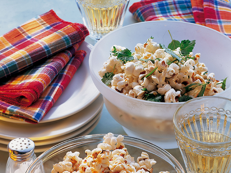 Bowls of popcorn with sparkling white wine