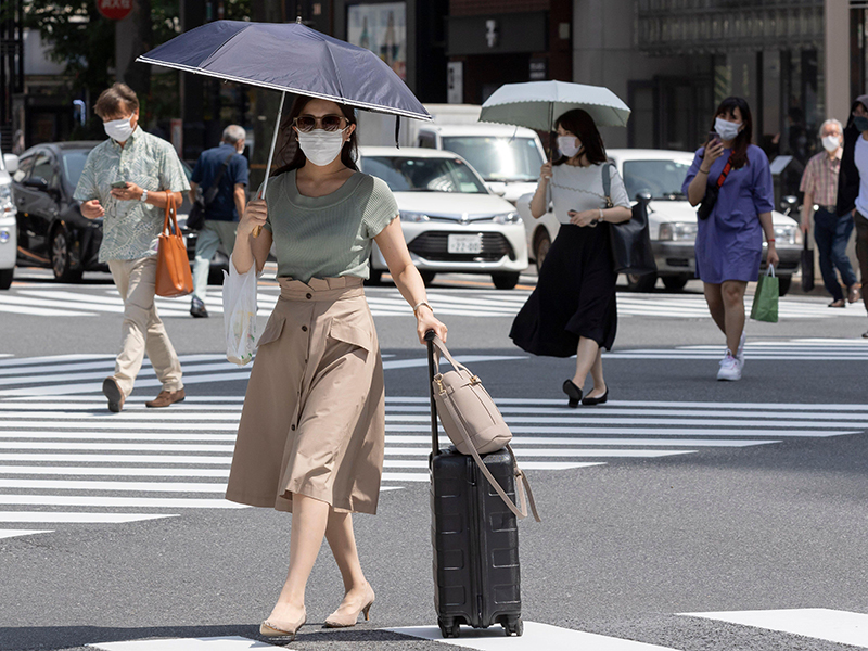 Pedestrians wearing masks in Tokyo, Japan, a top player in the Asia Pacific real estate market