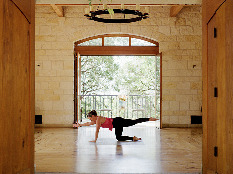 A woman holding a yoga pose