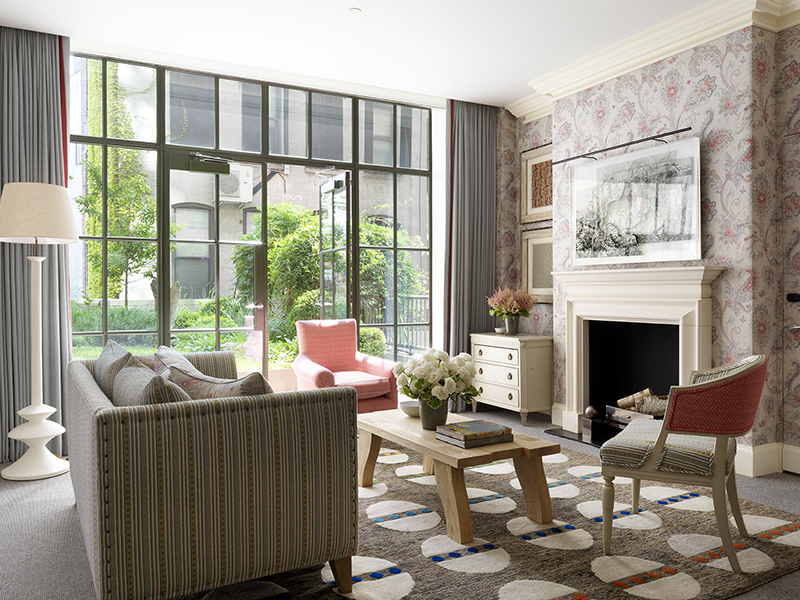 The living room and private garden terrace of the Meadow Suite