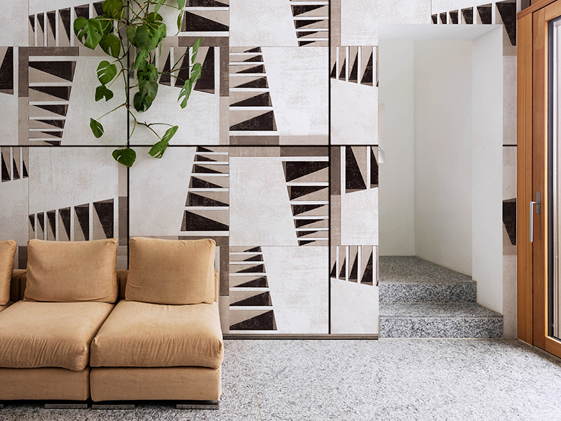 An abstract wallpaper design and sofa