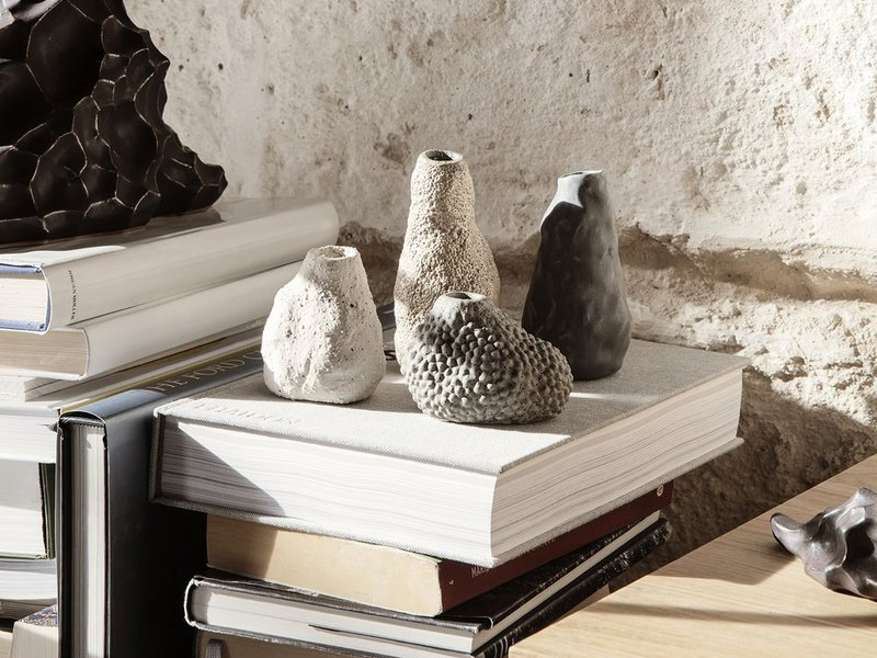 An arrangement of four small vases made from stone, an example of Japanese Interior Design by Kagu Interiors