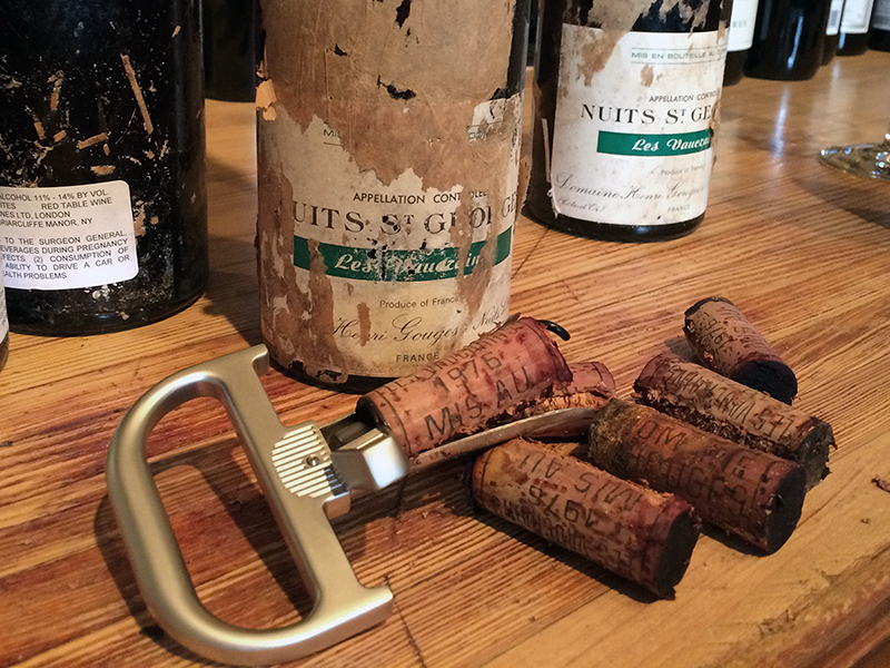 The Durand corkscrew surrounded by old bottles of wine