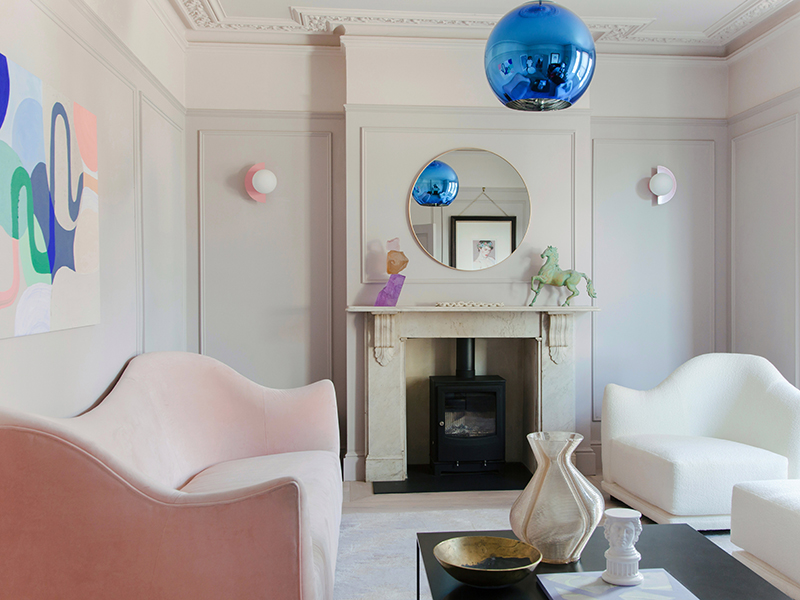 A white living room with pops of pastel colors