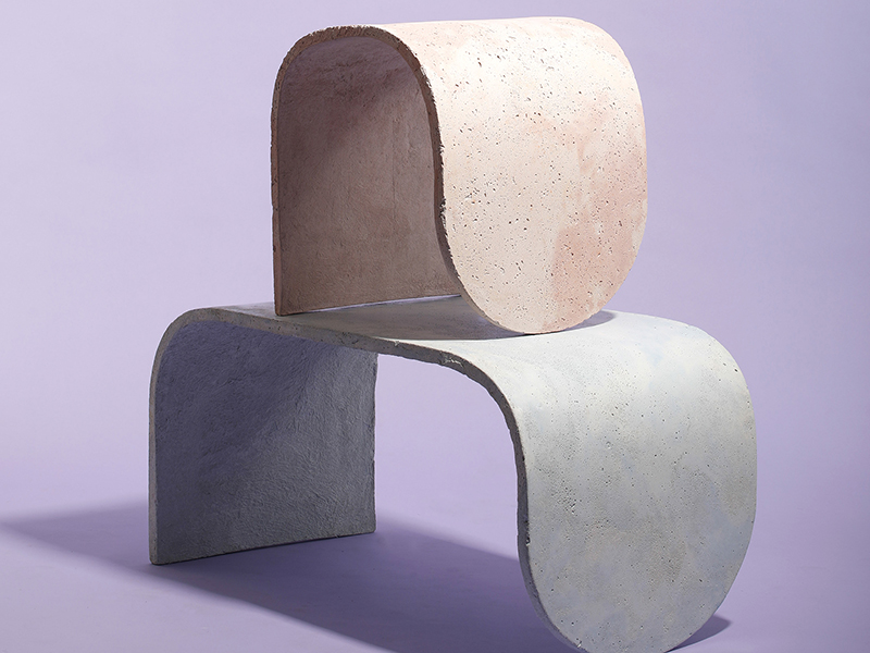curved concrete stools in various colors