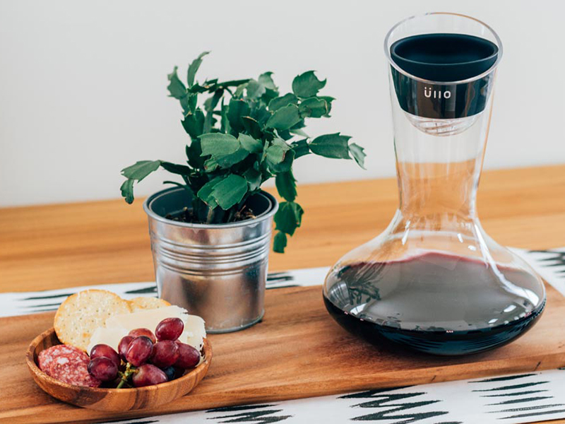 Ullo wine decanter with a small plate of snacks