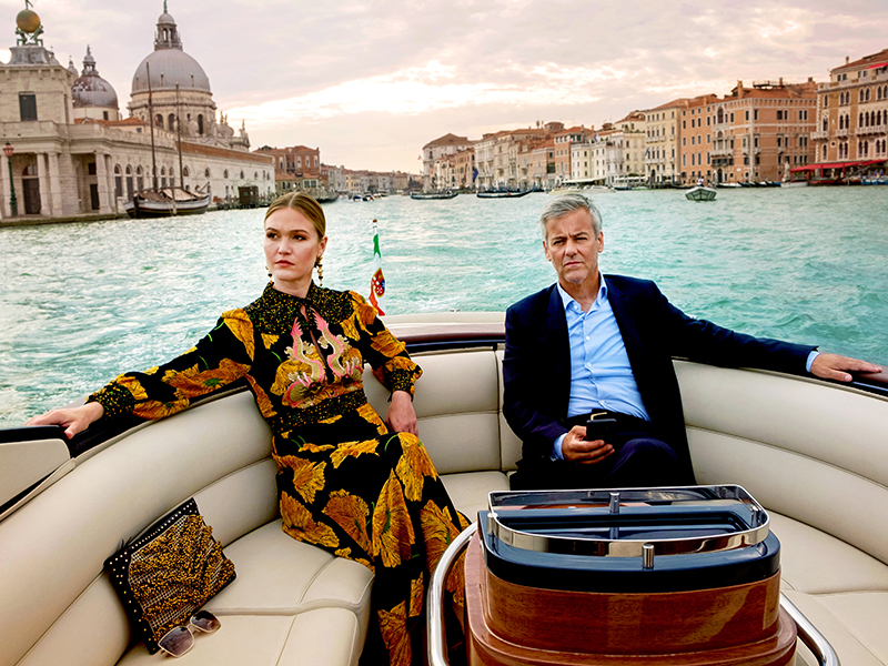 Lead actress of Riviera on a speed boat in Venice