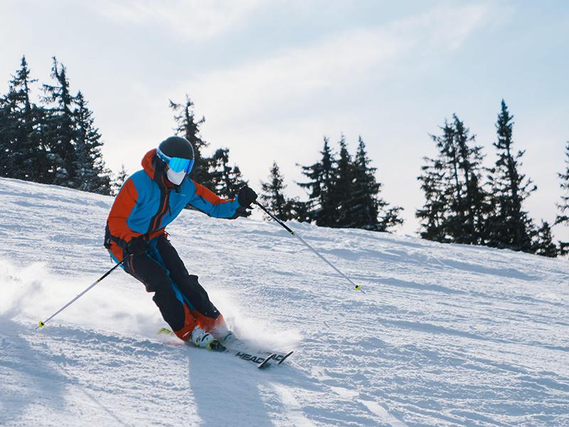 A man wears a mask while skiing during the Colorado ski season