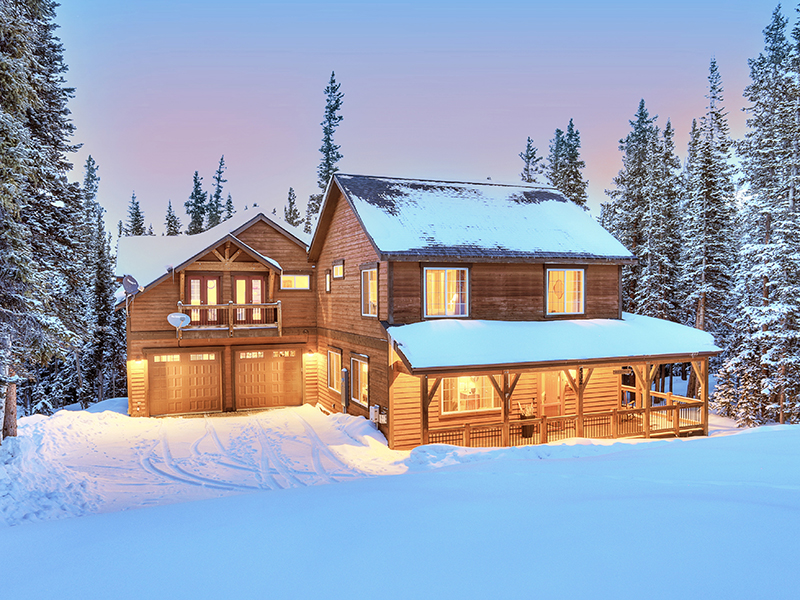 A home in Breckenridge surrounded by snow