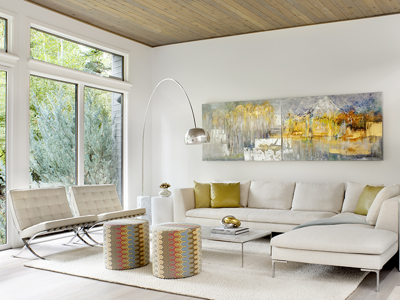 The beautifully decorated living room of 55 Overlook Drive, Aspen, has views onto fir trees