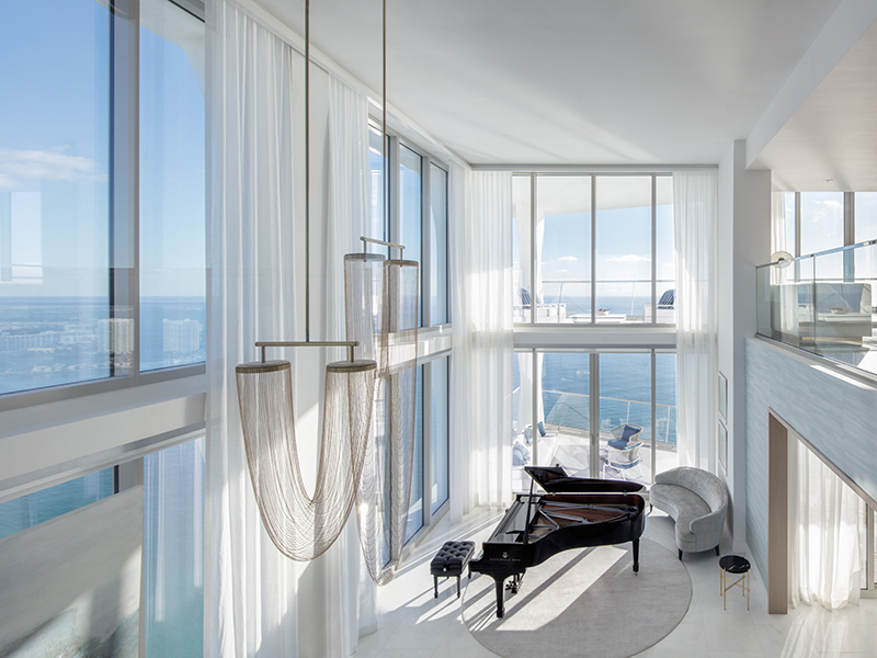 The living room with sea views at Upper North Sky Villa, one of Miami's modern luxury penthouses