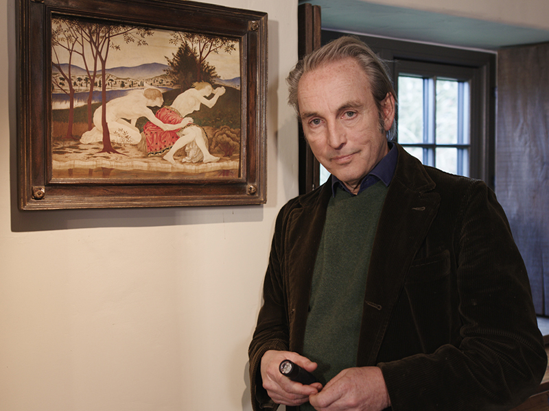 Art dealer Philip Mould pictured in front of a painting