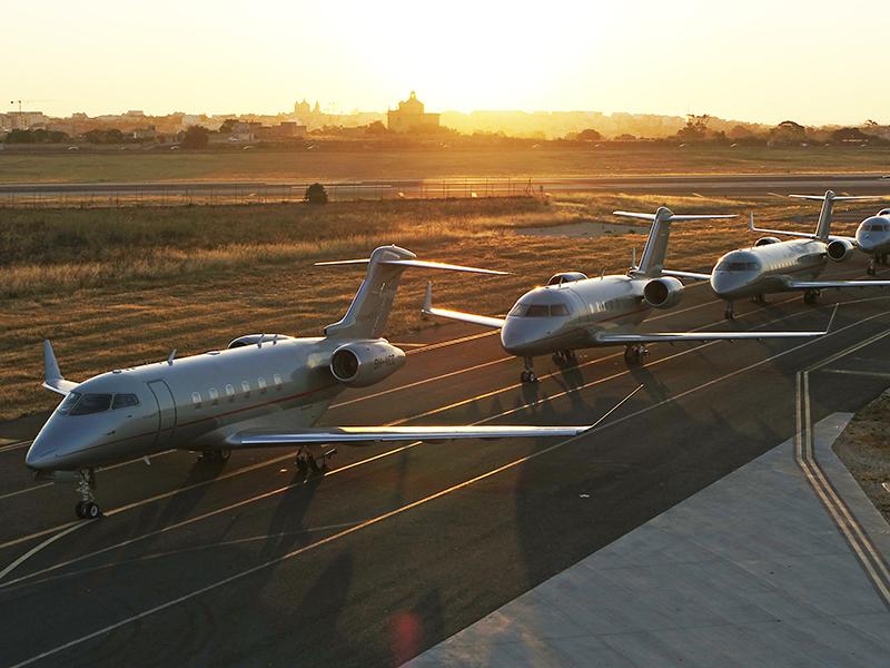 A fleet of VistaJet planes on the runway