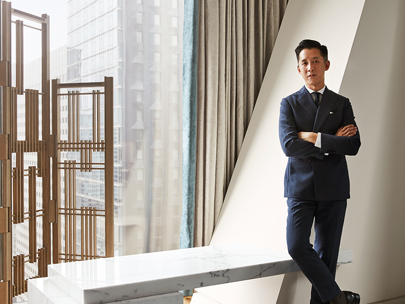 André Fu surrounded by modern organic decor in the 53W53 private residence in New York
