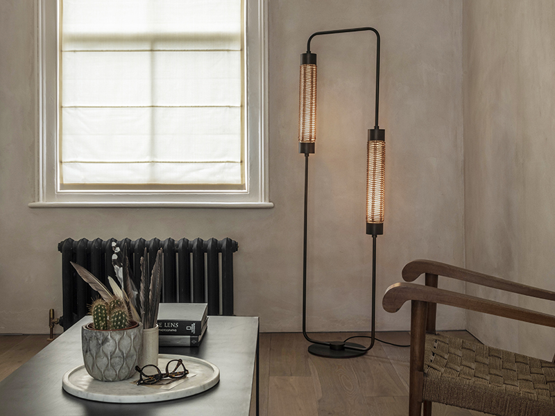 Floor lamp, table and chair in a room
