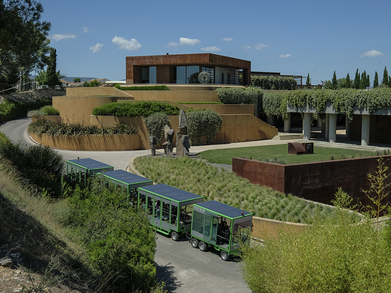 An electric tram outside the Familia Torres producer of sustainable wines