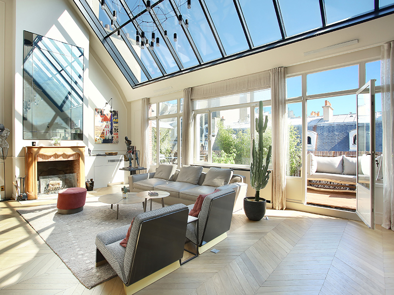 A modern apartment with high glass ceiling