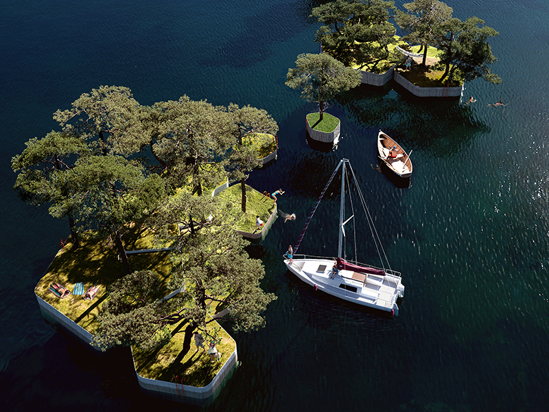 Aerial view of small man made islands and sailing boats