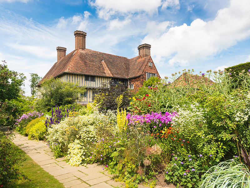 A full, colorful wild garden and historic house
