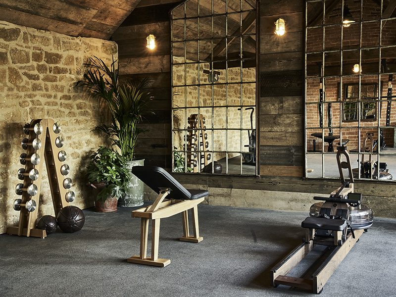 One of the designer gyms created by Gym Marine with wooden workout equipment