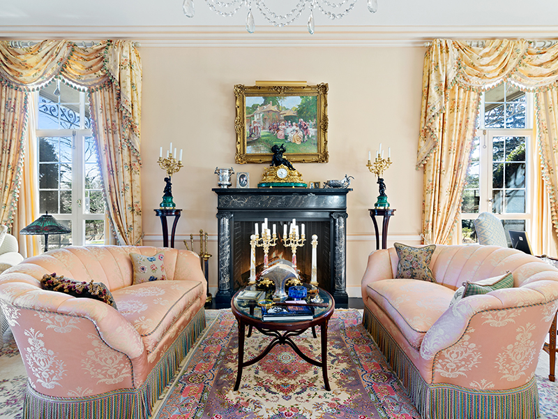 A living room with sumptuous pink-fringed sofas