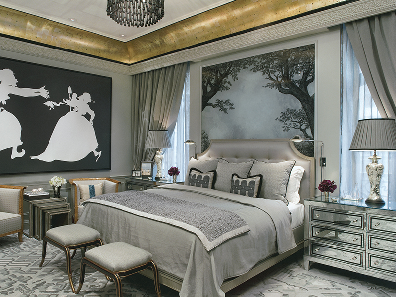 A hotel room in shades of gray and silver