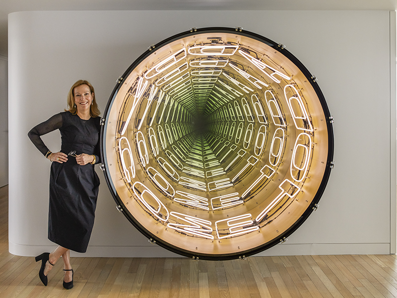 Suzanne Lovell poses in front of a piece of modern art, which she incorporates in her interior design projects