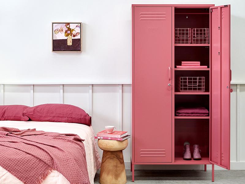 A pink double locker in a bedroom
