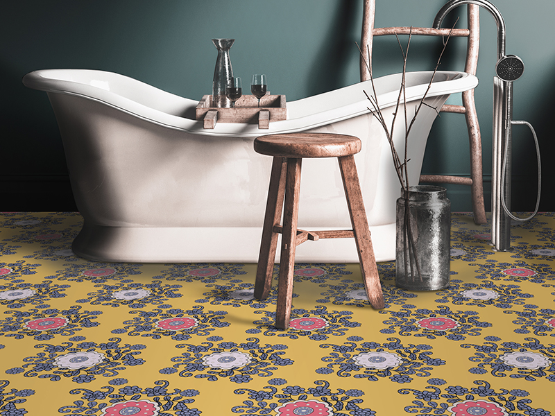 A colorful yellow and pink floral floor in front of a bathtub
