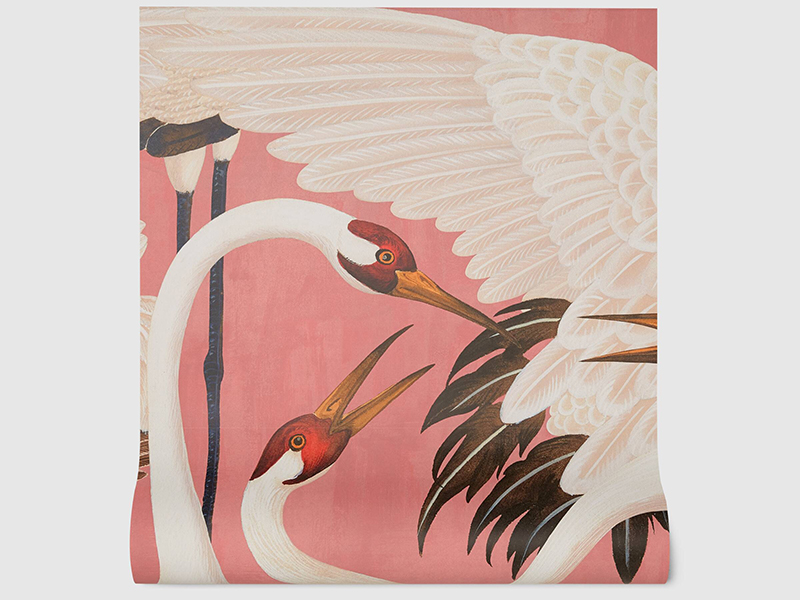 Pink wallpaper with a design of heron birds