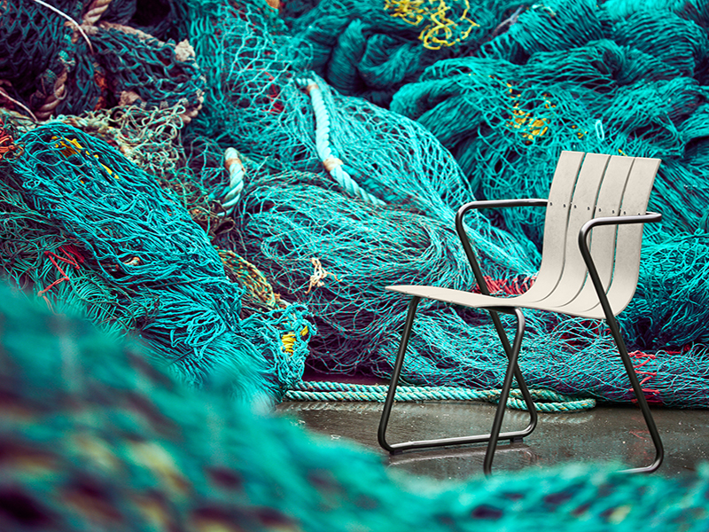 Ocean chair surrounded by fishing nets