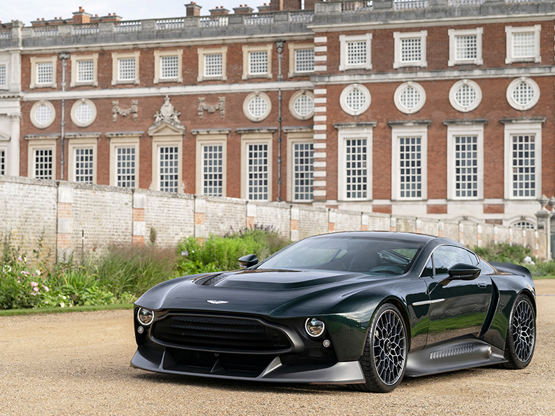An Aston Martin Victor parked in front of Hampton Court Palace