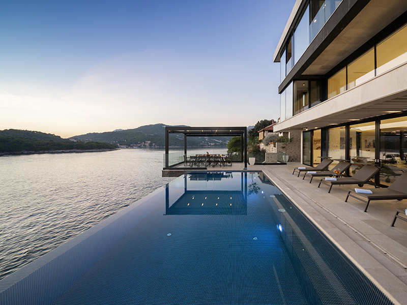 An infinity pool overlooking the sea at sunset