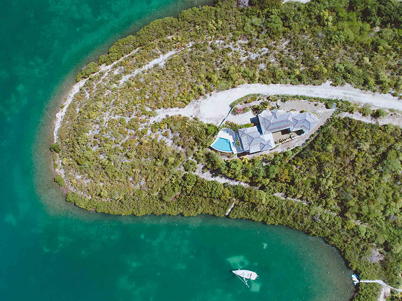 An aerial view of a waterfront estate in Antigua
