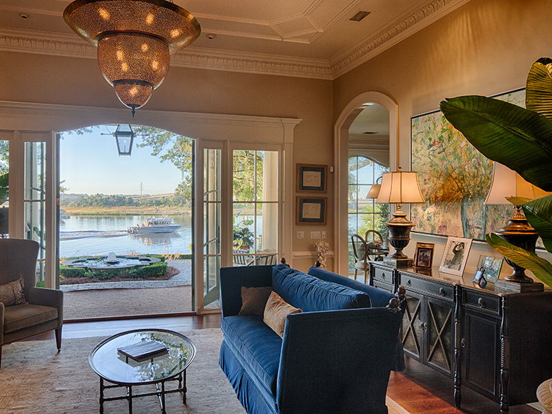 A grand living room with views out onto a river