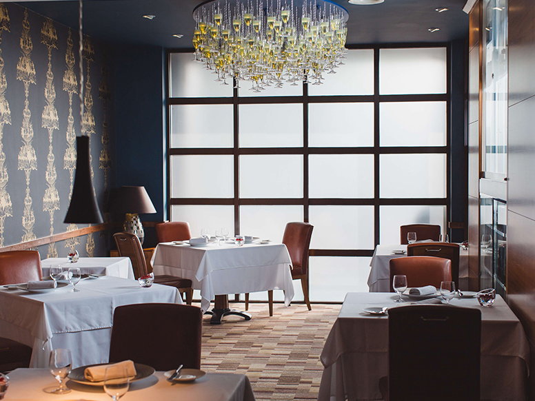 Elegant art deco, dark wood paneled dining space