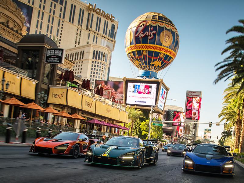 McLaren cars drive down a Las Vegas street