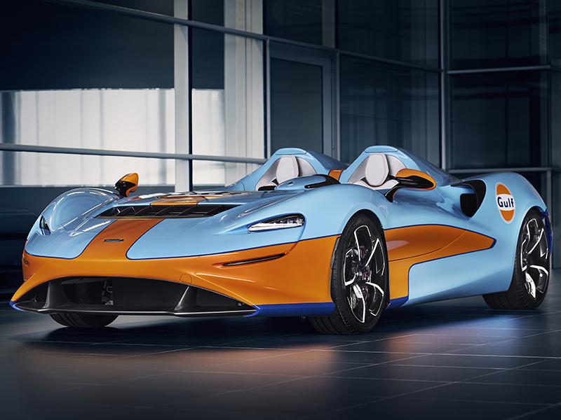 A blue and orange McLaren Elva
