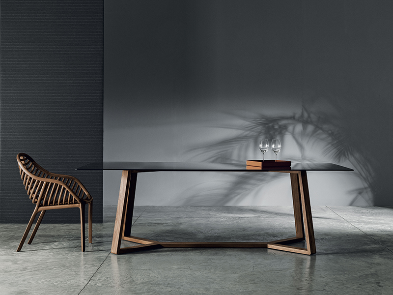 Table and chair in front of a gray wall